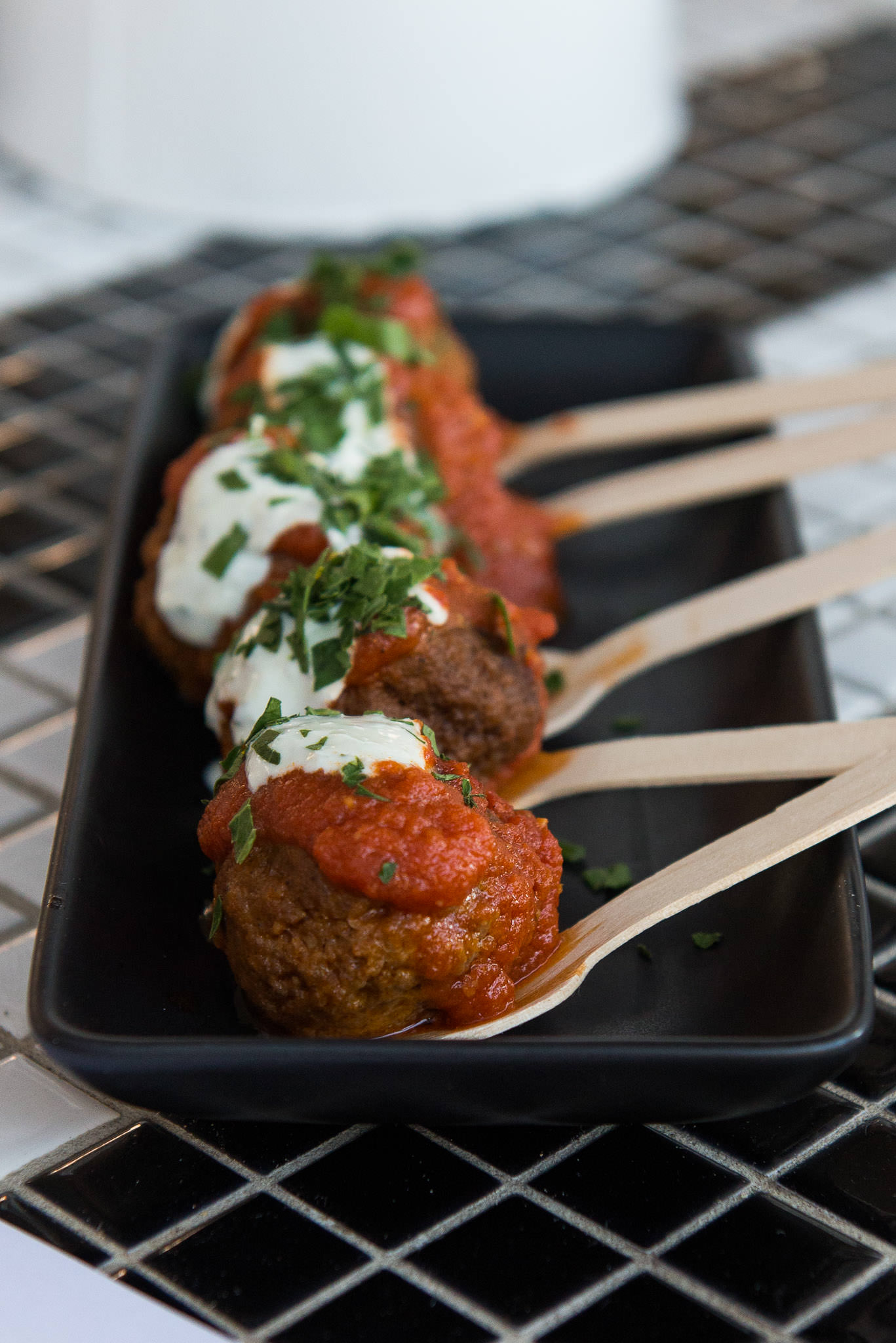 Spicy lamb meatballs with tomato sauce and yoghurt (AU$9)
