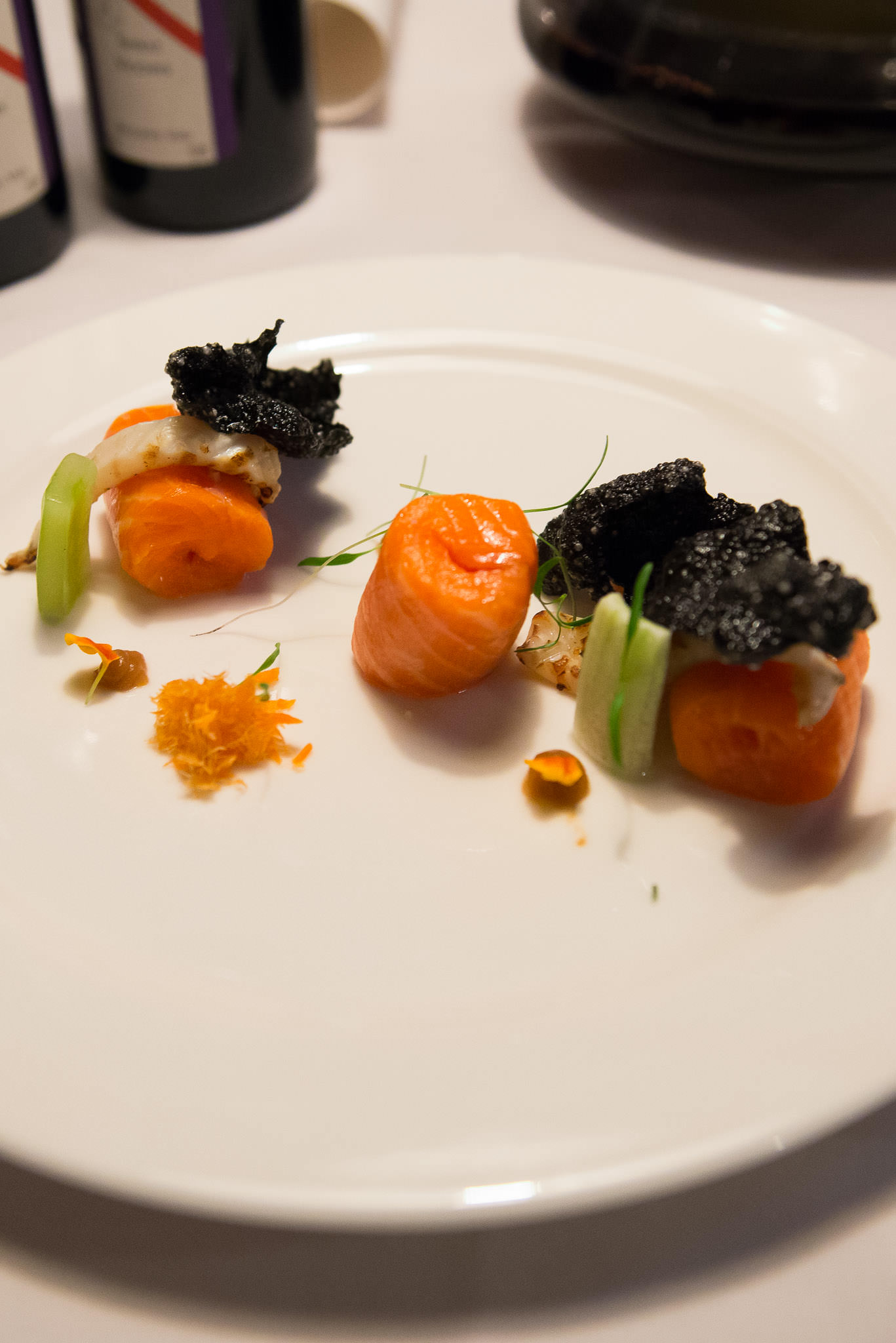 Barely cooked ocean trout, ink rice cracker, miso, cuttlefish and compressed cucumber