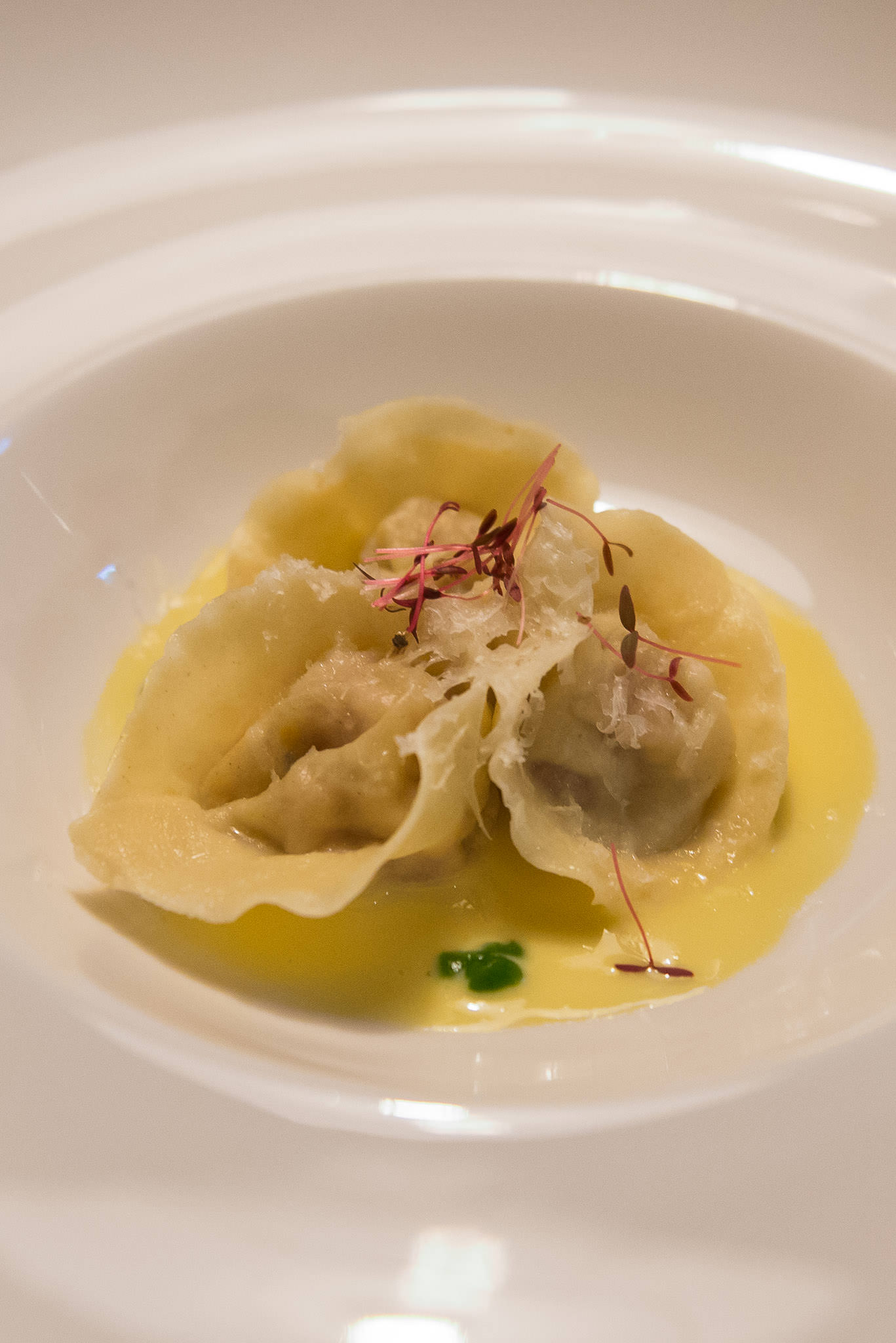 Al dente: handmade tortellini with caramelised sweetbread and orange, champagne cream, parsley puree