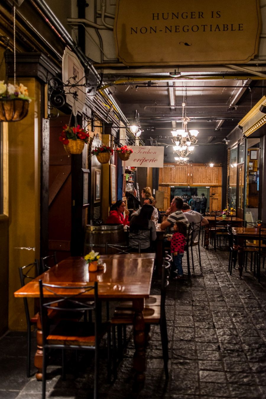 >Inside Elliott Stables, a sign above the cobbled laneway reads: Hunger is non-negotiable