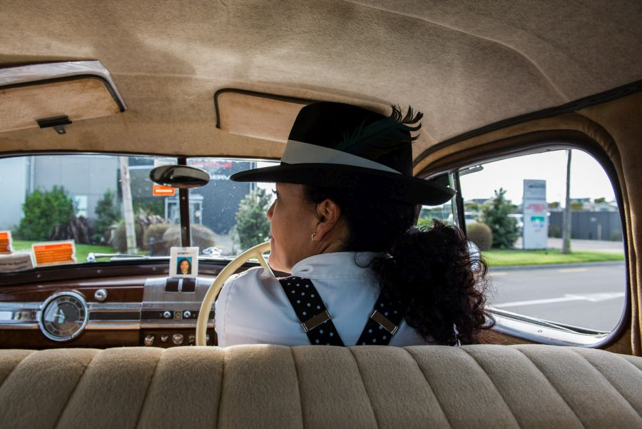 Riding in a vintage car with driver Tery