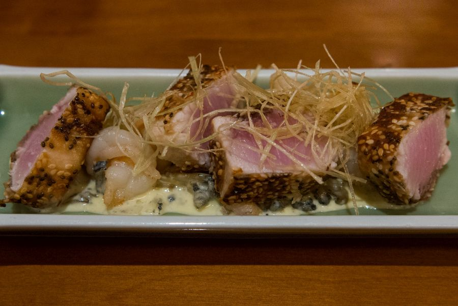 Sesame-crusted swordfish, sauteed prawns, spicy coconut creamed paua