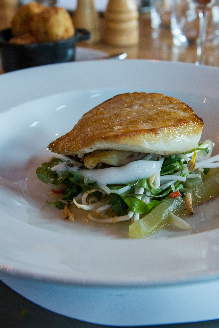 Pan-fried line caught fish, cucumber, garden herb salad, sprouts, chilli and kaffir lime (NZ$37.50) - the fish of the day was blue nose.
