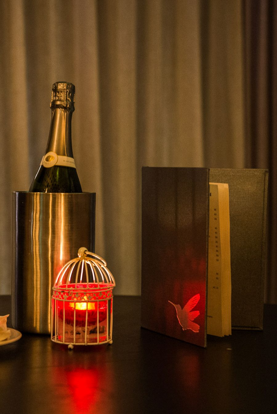 Champagne, lamp and menu - The Aviary
