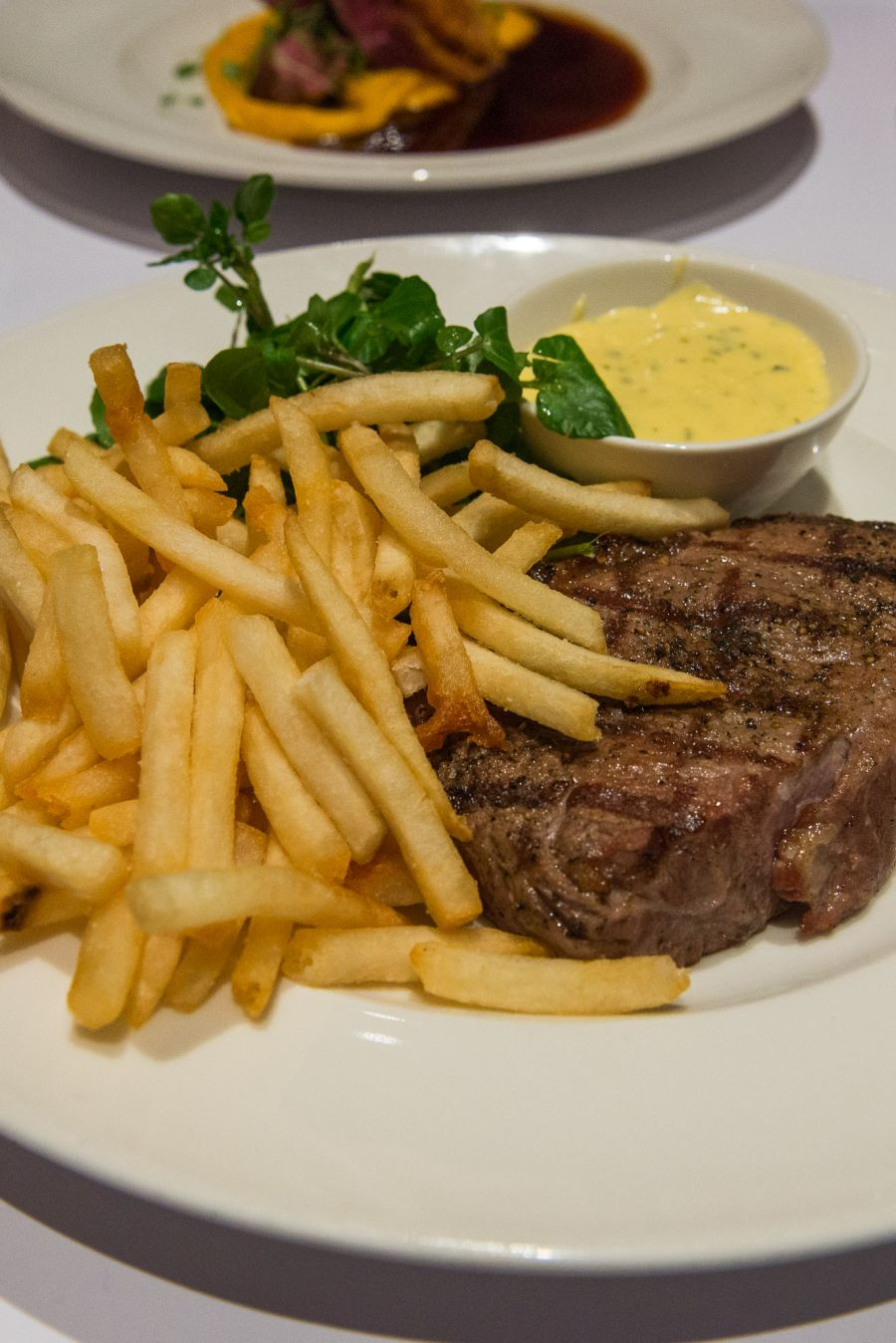 Chargrilled Butterfield sirloin steak (270g, dry aged for 28 days), bernaise sauce, frites, watercress salad (AU$46)
