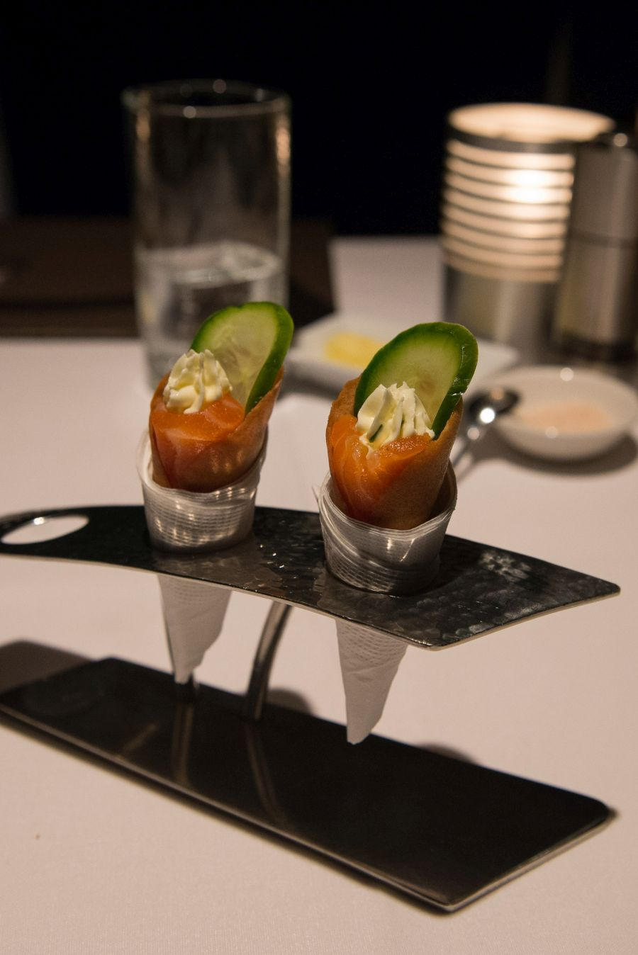 Amuse bouche - G&T cured salmon, cucumber and cream cheese in anchovy-flavoured cone