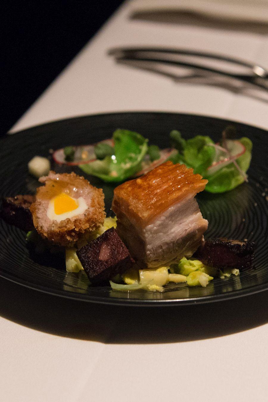 Roast pork belly, black pudding, scotch quail egg