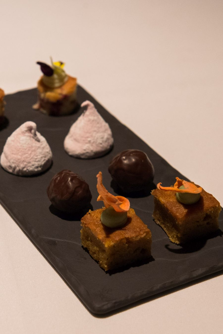 The 'things' served with coffee: carrot cake with dehydrated carrot and green tea ganache; Captain Morgan rum balls, marshmallow and white chocolate and raspberry torte