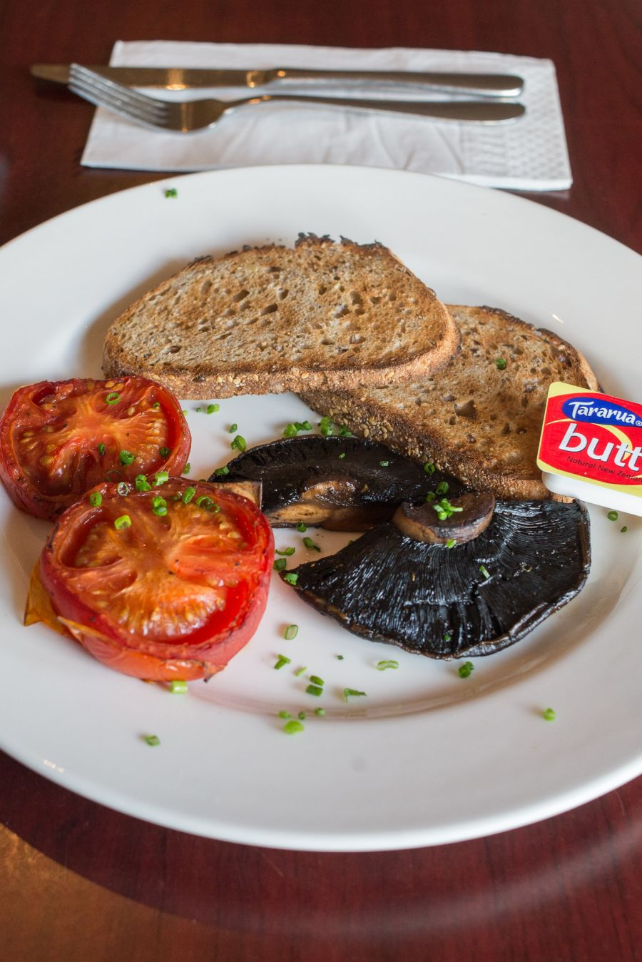 Field mushrooms and tomatoes with wholegrain toast (NZ$11)