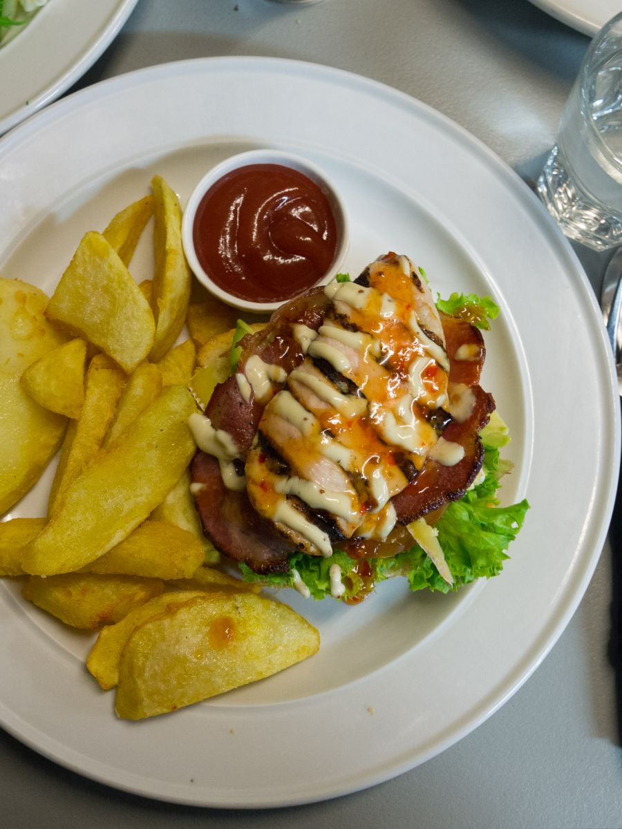Open chicken and bacon sandwich served on sourdough with homemade chunky fries and sweet chilli sauce (NZ$16)