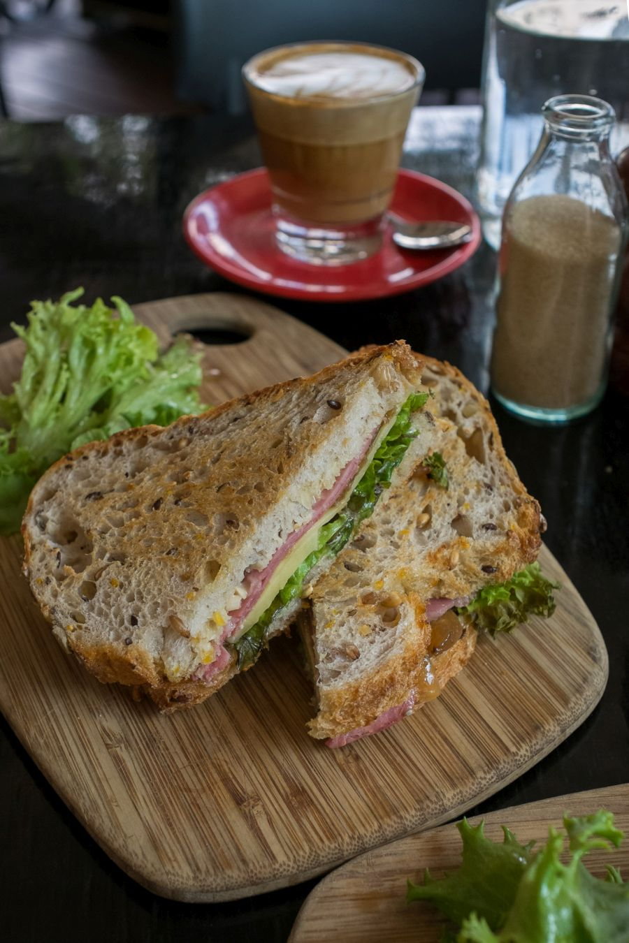 Corned beef, cheese, lettuce, caramelised onion sandwich
