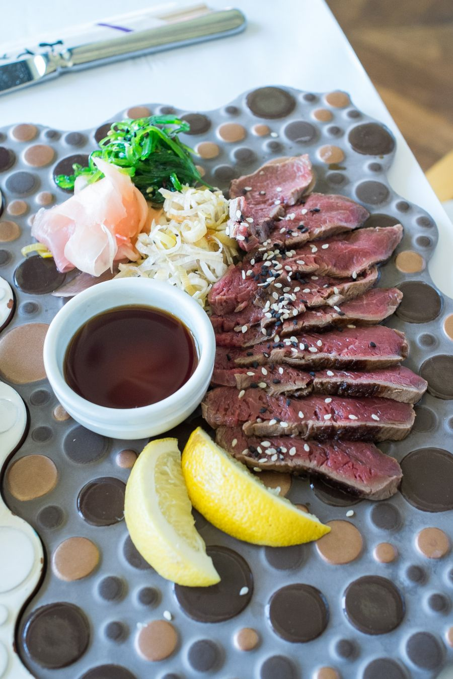 Beef tataki (AU$19) - thinly sliced aged beef fillet, served with slow braised leek, ponzu sauce