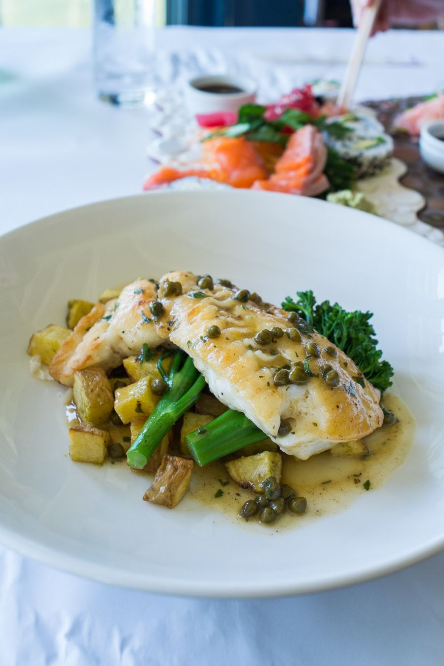 Fish special - groper gently  grilled, with broccolini and skillet potatoes with lemon caper sauce (AU$52)