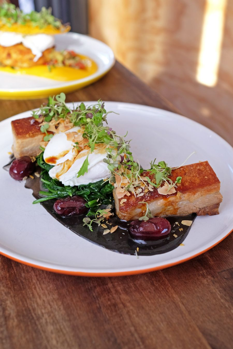 Pork Belly (AU$22.50) - two poached eggs, almond crumb, grapes, squid ink and anchovy sauce