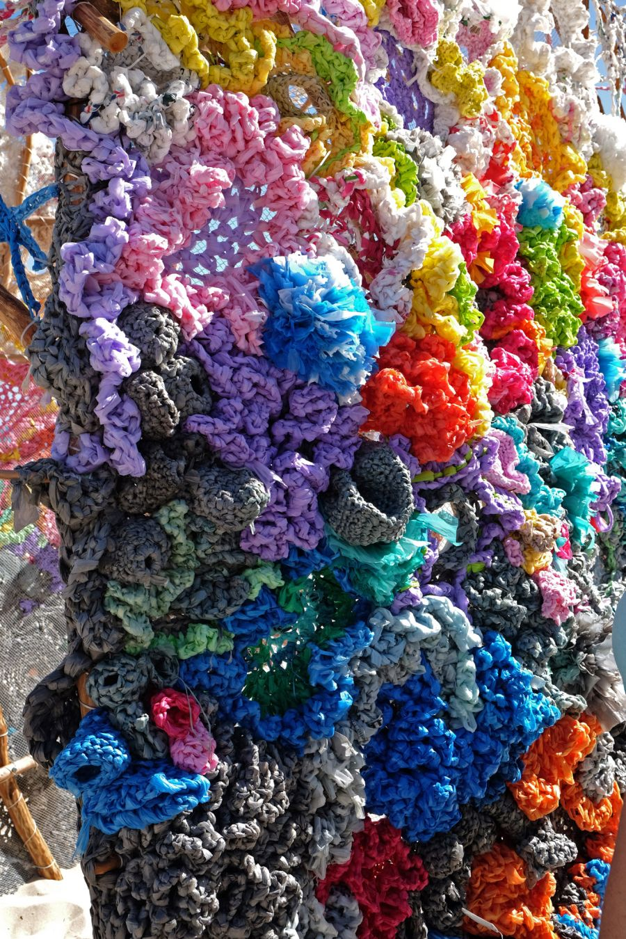 Rescheduling permanence by Helen Seiver. Wood, crocheted plastic bags - close up.