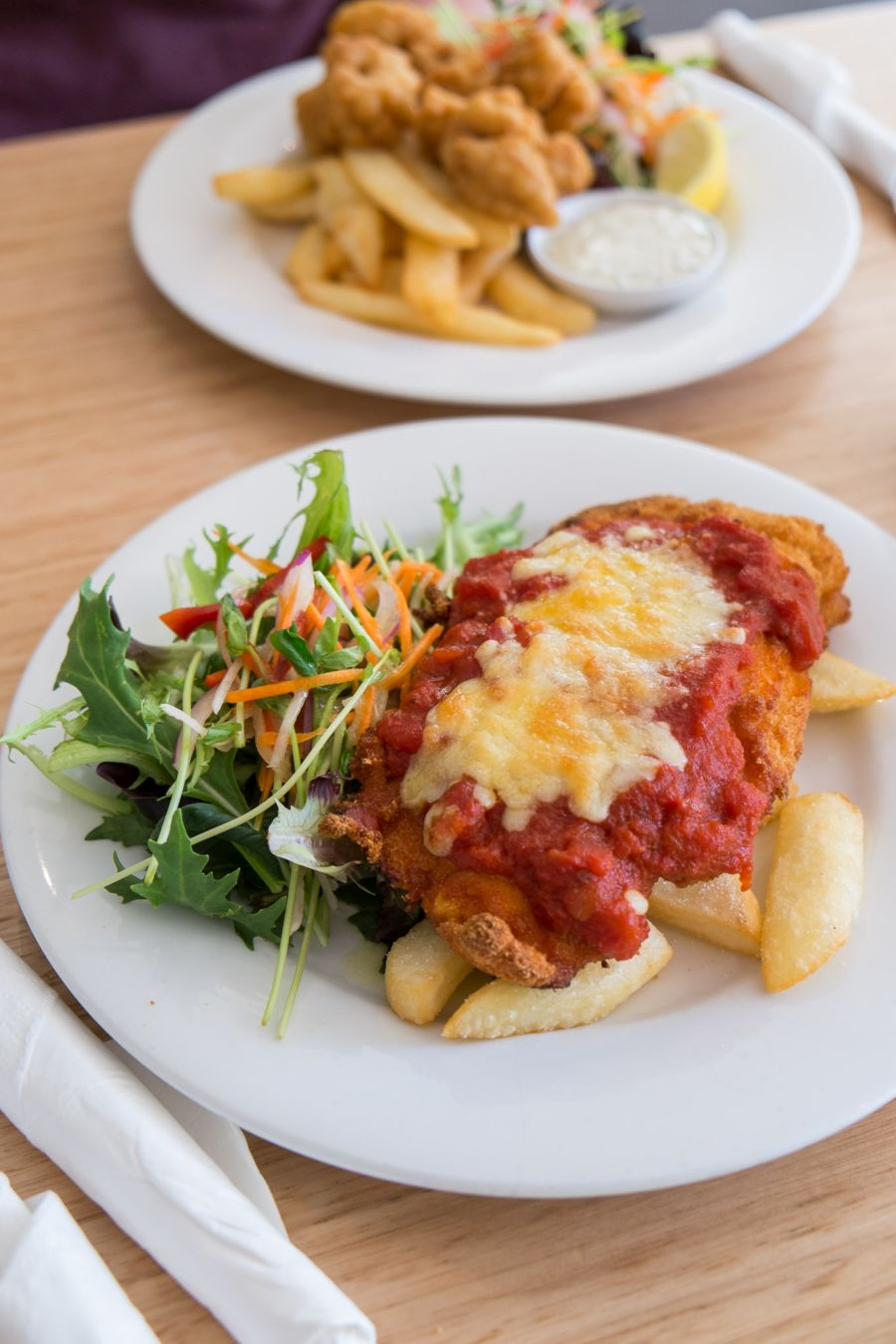 Chicken parmigiana with chunky chips and salad (AU$15 - tour menu)