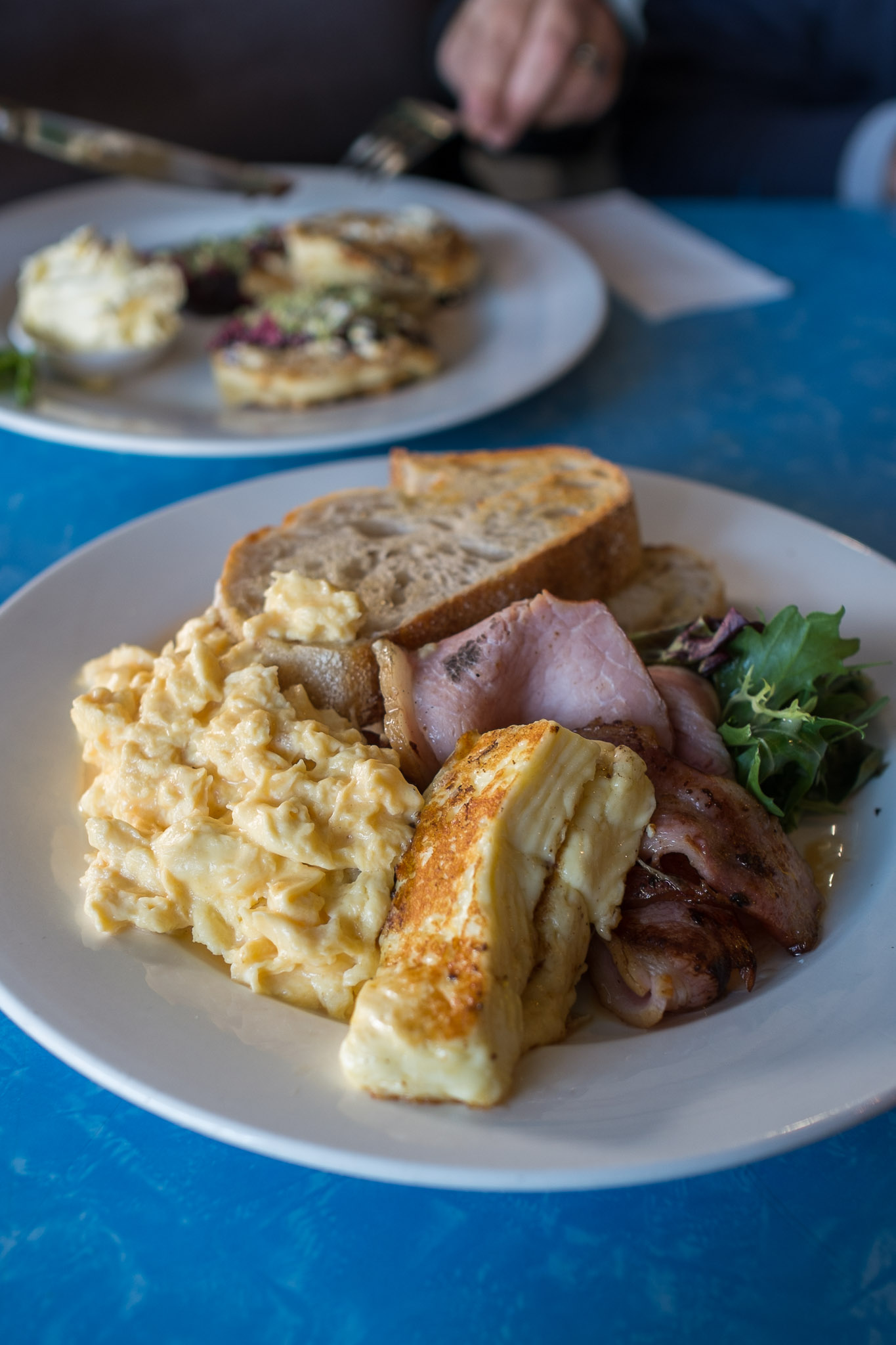 Scrambled eggs with sourdough toast (AU$10), bacon ($4) and grilled haloumi (AU$3.50)