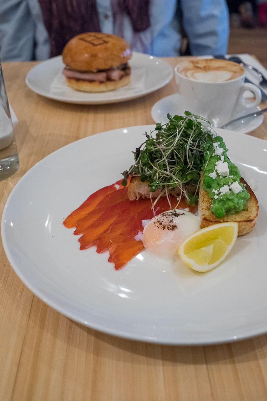 Beetroot cured salmon, crushed peas, feta, 64 degree egg, fresh herb salad, lemon (AU$20.50)