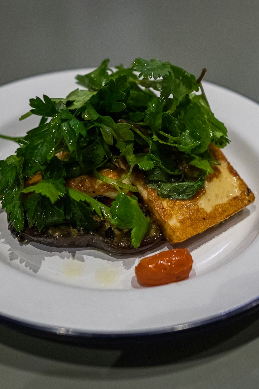 Marinated eggplant, grilled haloumi, tomato and herb salad (AU$16)