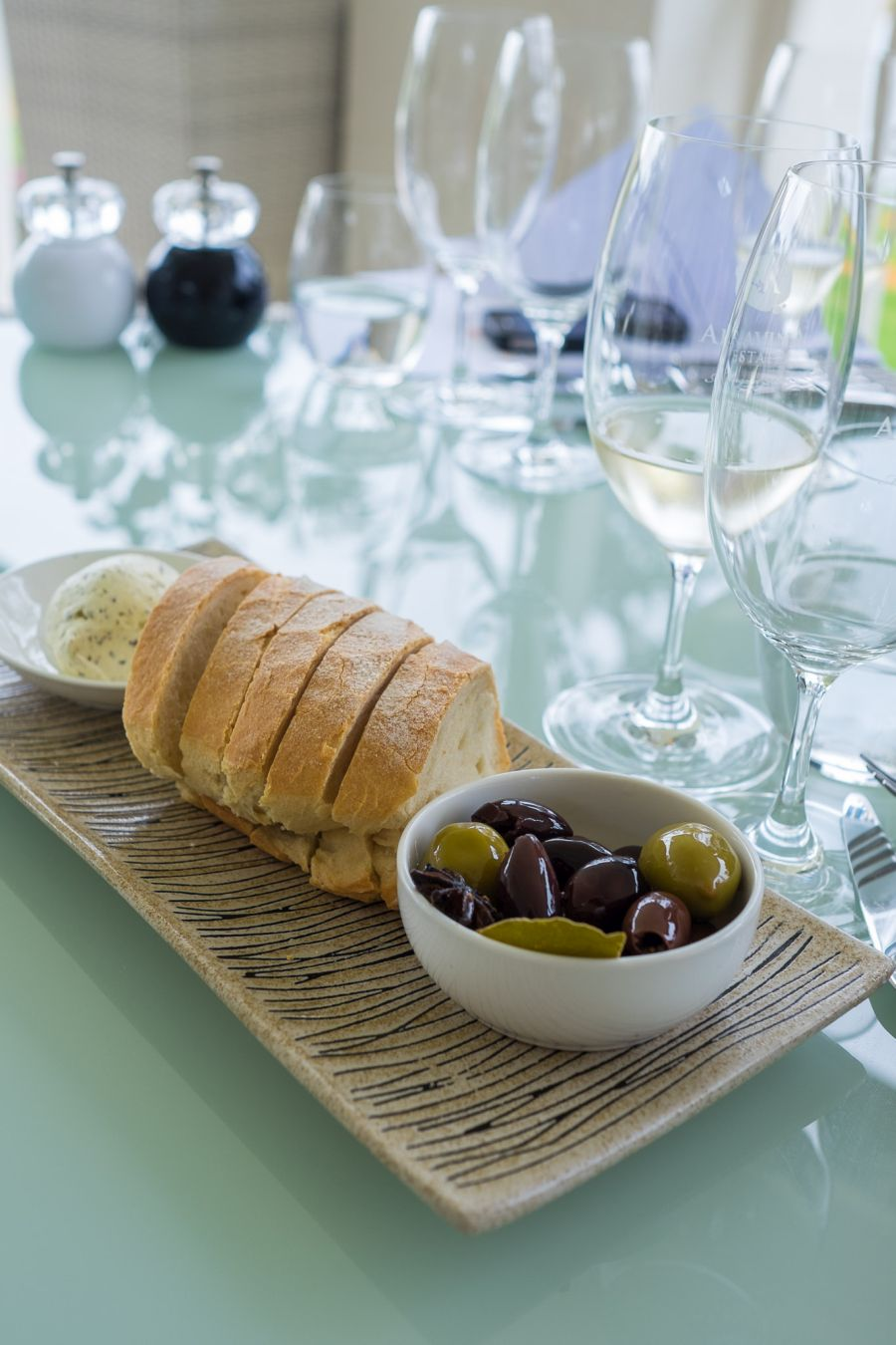 Marinated olives, freshly baked Aravina Estate bread, and whipped truffle butter