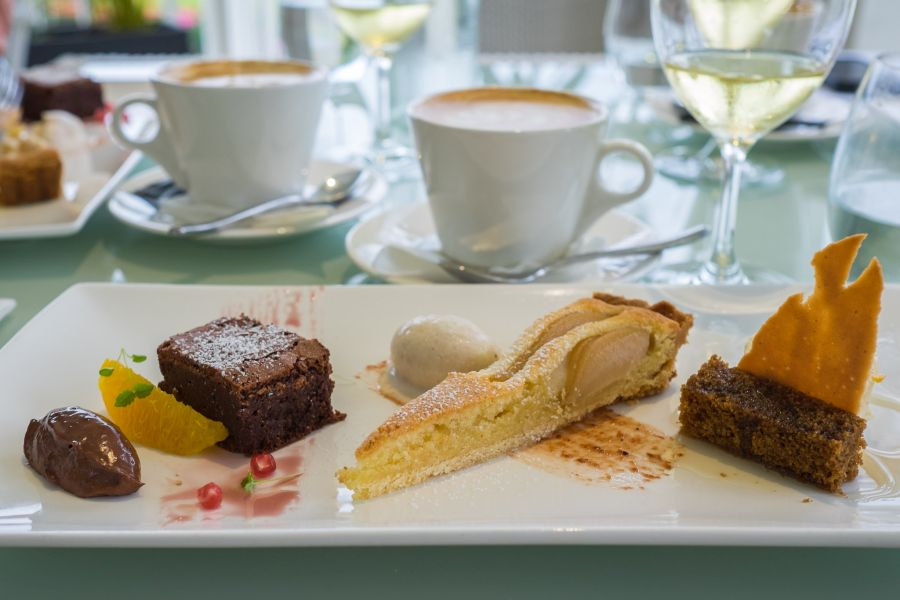 Dessert tasting plate: L-R: flourless chocolate cake with chocolate marquise; pear and frangipane tart and honey semi freddo ; spice cake with ginger syrup and ginger tuille
