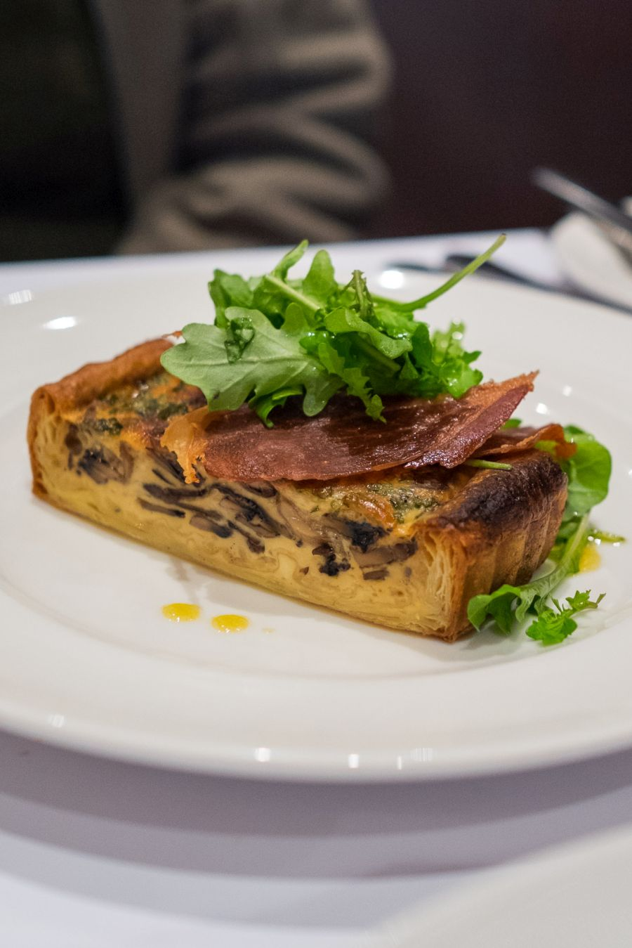 Portobello mushroom tart, rocket & prosciutto salad, red wine vinaigrette