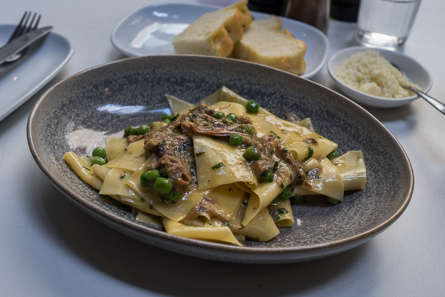 Handmade pasta with roasted lamb and fresh peas