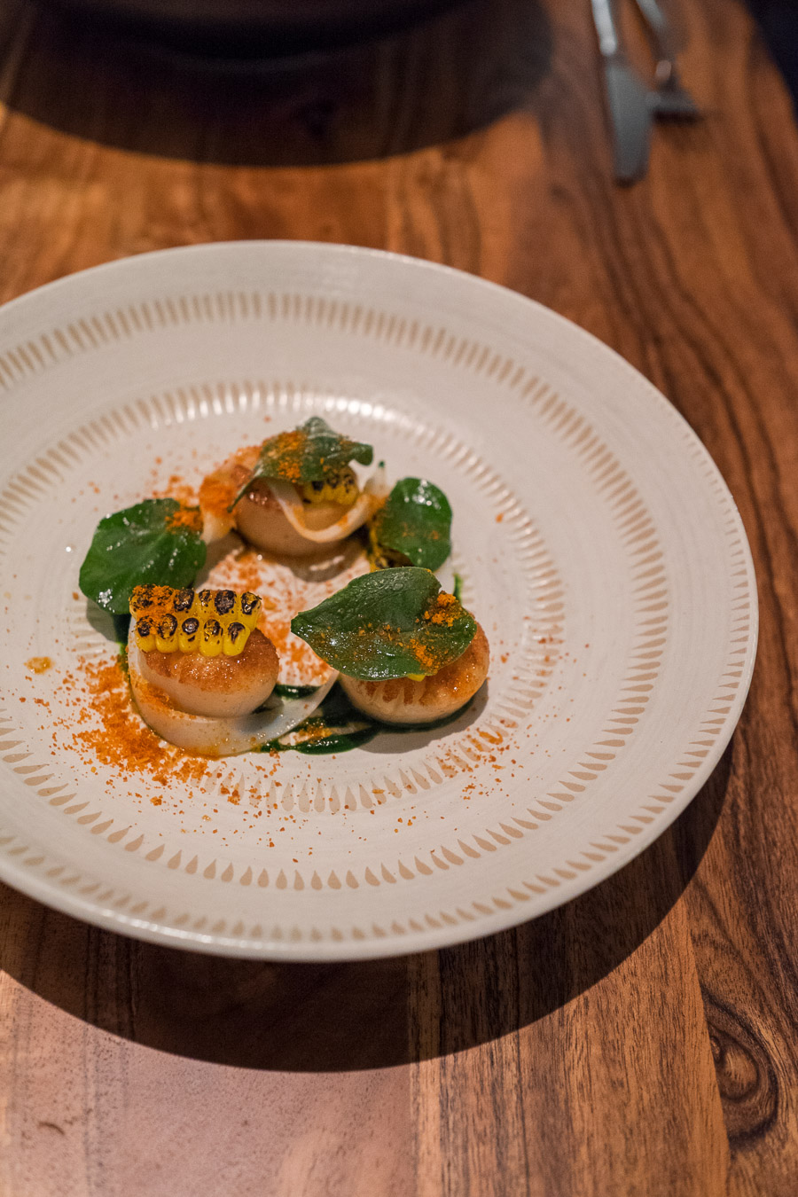 Scallops, corn, spinach + shaved squid