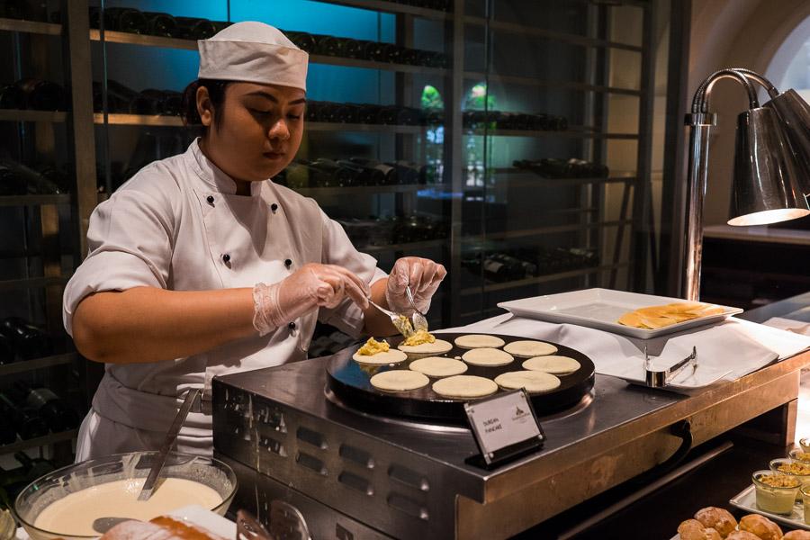 Making mini durian pancakes