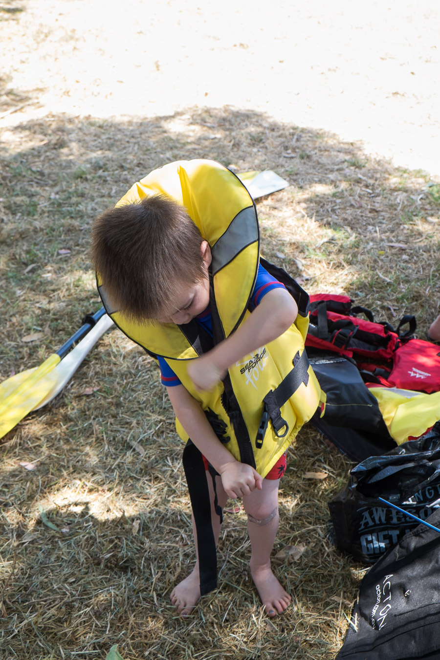 Caleb puts on his life jacket