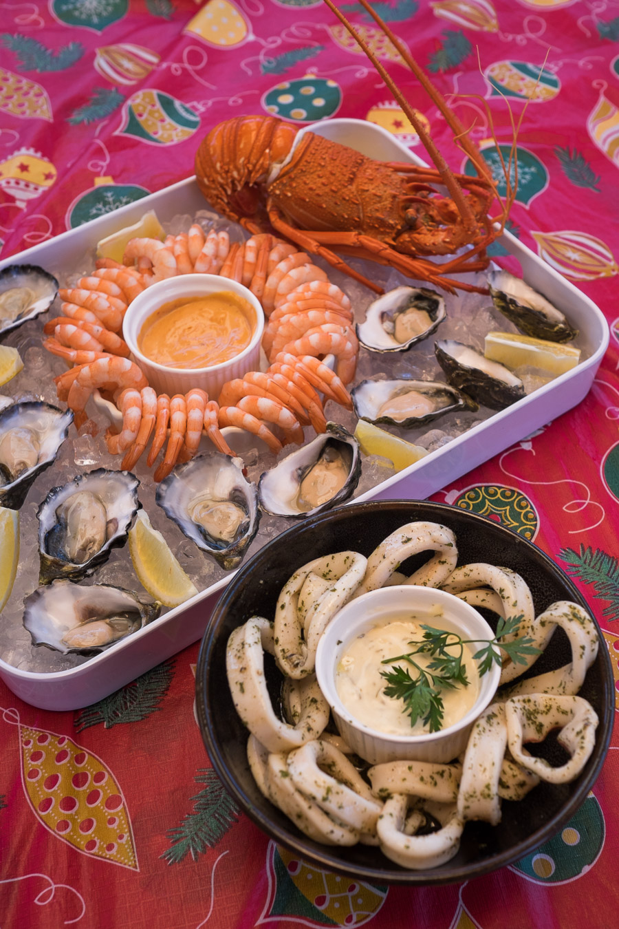 Prawns with seafood cocktail sauce, oysters natural with lemon and Tabasco (not pictured) and marinated calamari with garlic sauce