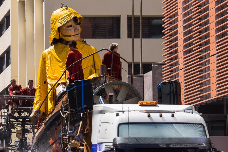 The Little Girl giant arrives dressed in a yellow sou'wester, sitting in a boat. Hay Street, Saturday.