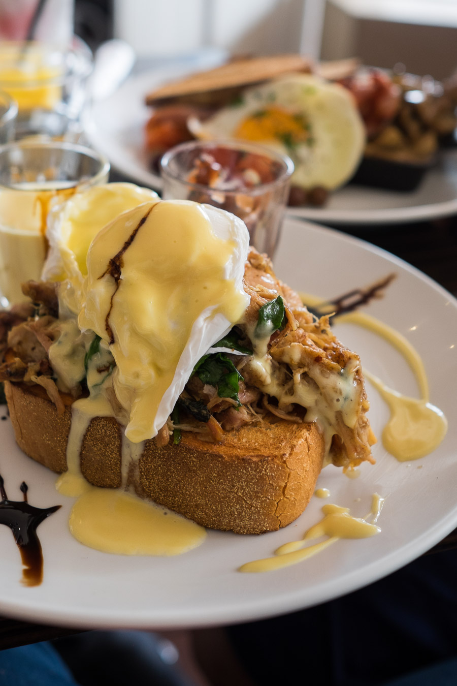 Pulled pork Benedict with two poached eggs, wilted spinach, onion jam, hollandaise and thick toast (AU$19.50)