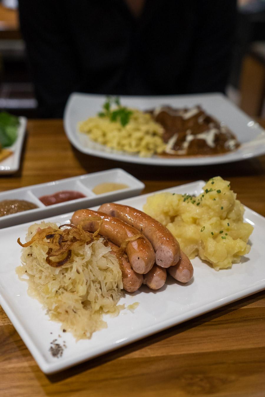 Pork sausages with sauerkraut and potato salad