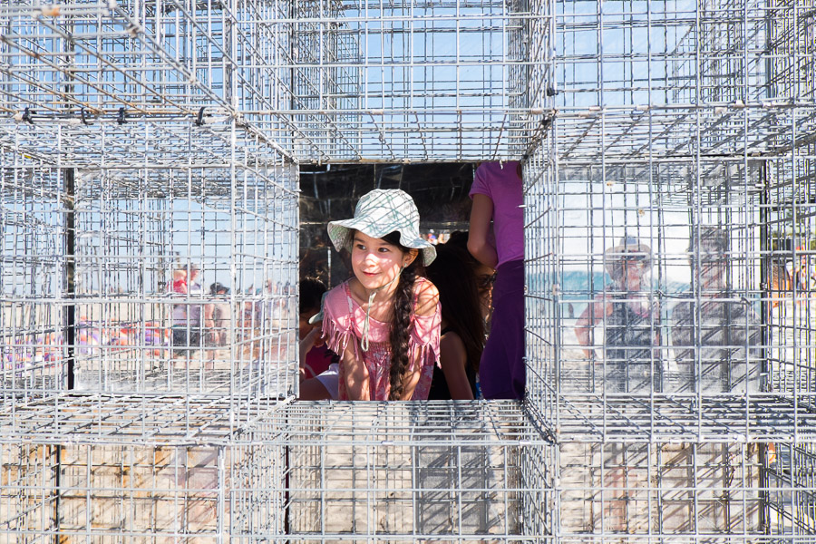 Ruby in the House of mirrors by NEON - mirror finish stainless steel, gabion cages