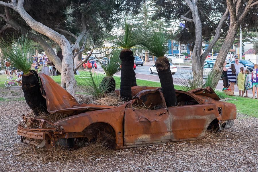 Victory or revenge by Tim Burns - steel, fibregrass, Balga trees