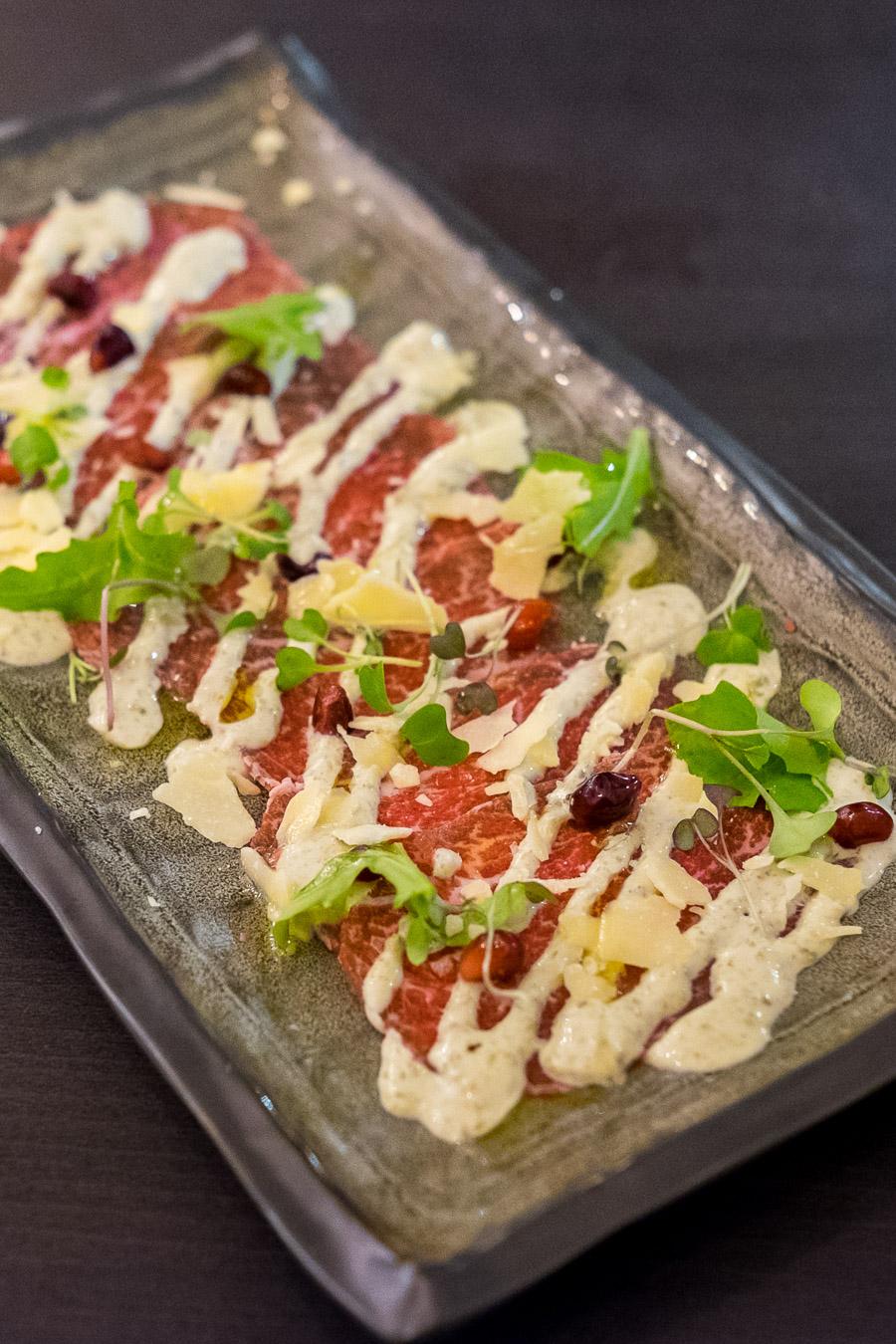 WA grass-fed beef carpaccio, caper mayonnaise, pomegranate, rockmelon, micro herbs (AU$14)