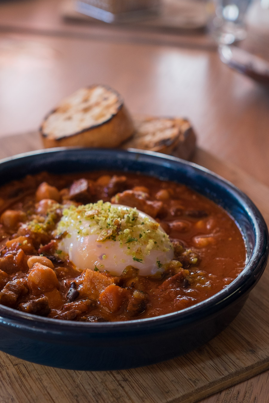 From the AU$18 Rapido menu - feijoada - Brazilian pork and bean stew, slow cooked egg, bread