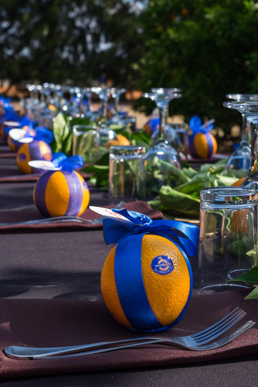 The table setting included a Midknight Summer orange for each guest.