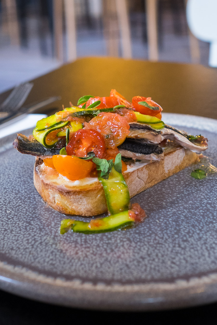 Smoked sardines on toast with tomato escabache, marjoram and salted lemon (AU$16)