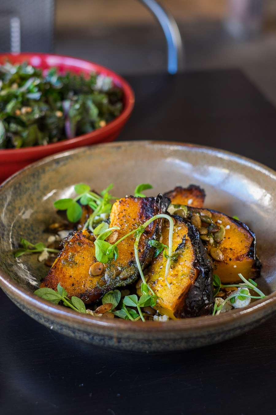 Wood-roasted pumpkin, feta, spiced pepita and snow pea sprouts (AU$14)