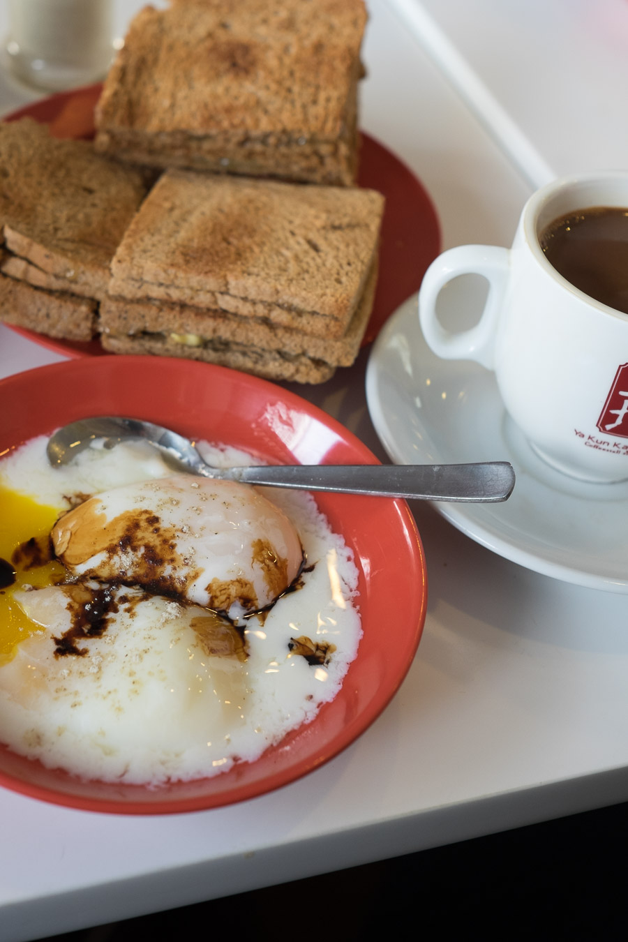 Kaya toast, soft boiled eggs and coffee c