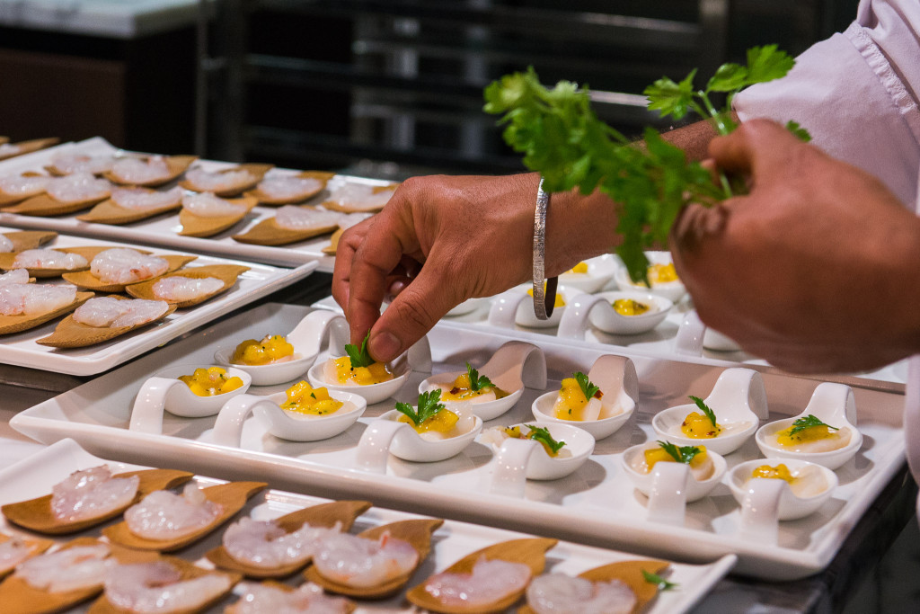 Garnishing the scallop carpaccio and mango